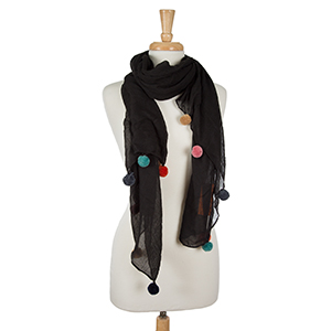 """Lightweight black, open scarf with pom poms along the bottom edges. 65% polyester and 35% viscose. Measures 36"""" x 66"""" in size."""
