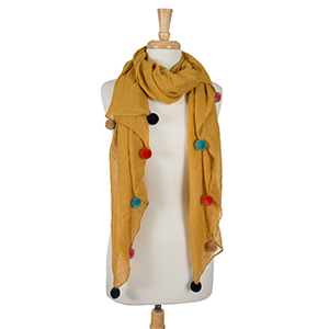 """Lightweight mustard yellow, open scarf with pom poms along the bottom edges. 65% polyester and 35% viscose. Measures 36"""" x 66"""" in size."""