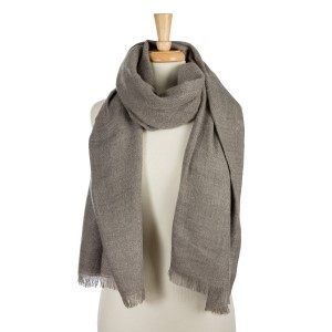 """Solid gray scarf with fringe along the bottom hem. 100% acrylic. Measures 26"""" x 72"""" in size."""
