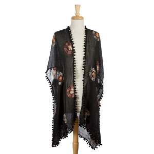 Black, lightweight kimono with floral embroidery and pom poms on the edges. 35% viscose 65% polyester. One size fits most.