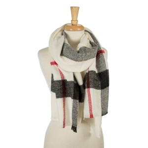 "White, heavyweight scarf with a large plaid print. 100% acrylic. Measures 26"" x 76"" in size."