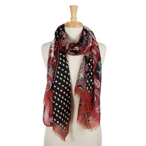 """Burgundy, lightweight scarf with a paisley and floral print and frayed edges. 100% viscose. Measures 36"""" x 72"""" in length."""