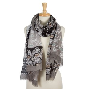 """Gray, lightweight scarf with a paisley and floral print and frayed edges. 100% viscose. Measures 36"""" x 72"""" in length."""