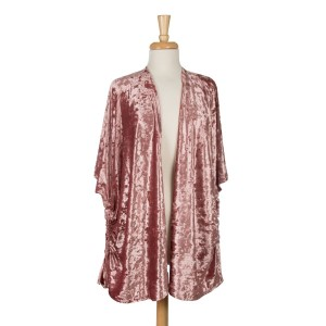 Crushed velvet, short sleeve, kimono with side ruching and a lined inside. 100% polyester. One size fits most.