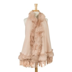 Hooded vest, with a faux fur trim and fringe along the bottom hem. 100% acrylic. One size fits most.