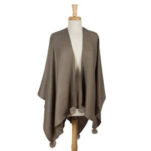 Taupe cape with pom pom accents. 100% acrylic. One size fits most.