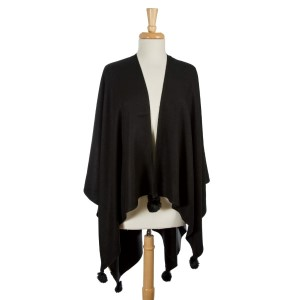 Black cape with pom pom accents. 100% acrylic. One size fits most.