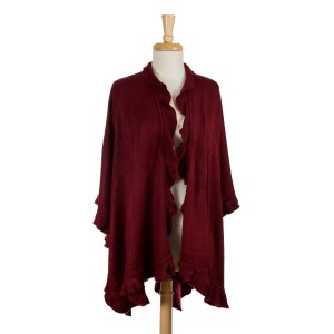 Burgundy knit cape with ruffled edges. 100% acrylic. One size fits most.