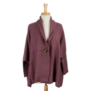 Purple knit sweater with an oversized, dolman fit and a front wooden button. 100% acrylic. One size fits most.