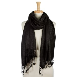 """Black lightweight scarf with metallic silver threaded details and tassels on the ends. 55% polyester and 45% viscose. Measures 26"""" x 72"""" in size."""