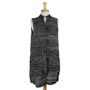 Black and white knit vest with two front pockets. 100% acrylic. One size fits most.