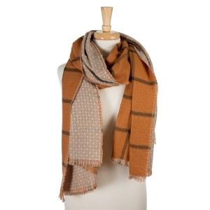 """Rust and olive green, heavyweight open scarf with a plaid print on one side and polka dots on the other. 100% acrylic. Measures 27"""" x 80"""" in size."""
