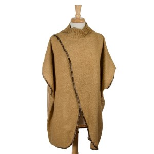 Tan short sleeve, mock turtleneck sweater poncho with an open front. 100% acrylic. One size fits most.