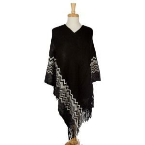 Knit poncho with a chevron pattern along the bottom and metallic detailing. 100% acrylic. One size fits most.