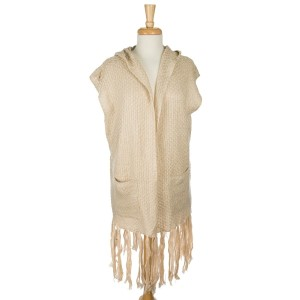 Knit, hooded vest with two front pockets and tassels along the bottom hem. 100% acrylic. One size fits most.