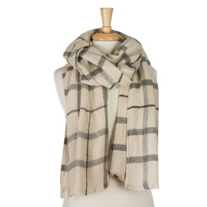 """Ivory and gray plaid, open scarf with frayed edges. 100% acrylic. Measures 25"""" x 80"""" in size."""