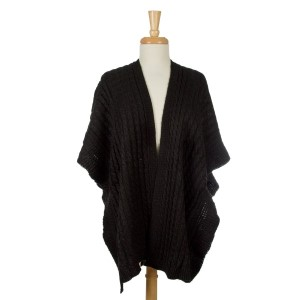 Knit cape, kimono with ruffled edges. 100% acrylic. One size fits most.