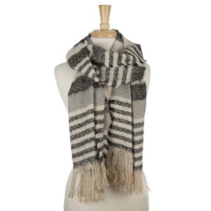 "Heavyweight, open scarf with a striped pattern and fringe along the ends. 100% acrylic. Measures 27"" x 80"" in size."