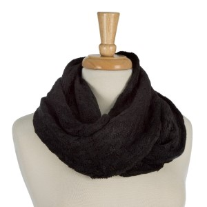"Knit infinity scarf with a faux fur inside lining. 100% acrylic. Measures 10"" x 31"" in size."