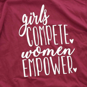 Girls Compete, Woman Empower - Short Sleeve Boutique Graphic Tee. Sold in 6 pack. Color: Maroon S:1 M:2 L:2 XL:1 100 % Cotton