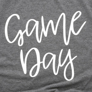 Game Day - Short Sleeve Boutique Graphic Tee. These t-shirts are sold in a 6 pack. S:1 M:2 L:2 XL:1   Color: Dark Grey  Fabric: 35% Cotton 65% Polyester