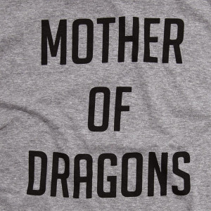 Mother of Dragons - Short Sleeve Boutique Graphic Tee. These t-shirts are sold in a 6 pack. S:1 M:2 L:2 XL:1 Color: Gray 50% Cotton 50% Polyester Brand: Anvil