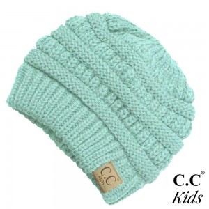 """C.C™ Kids MessyBun BeanieTail™. 100% acrylic. Measures 7"""" in diameter and 7"""" in length. Approximate fit: toddler to 7 years of age."""