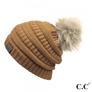 Cable knit, original C.C beanie with a faux fur pom pom, in mustard. 100% acrylic.