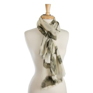 "Lightweight, ivory scarf with a washed out, olive green floral print. 100% polyester. Measures 36"" x 72"" in size."