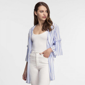 Lightweight, short sleeve kimono with a blue and white pinstripe, a pearl button closure and a ruffled sleeve. 100% cotton. One size fits most.