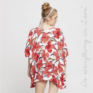 Lightweight, short sleeve kimono with a tropical flower print. 100% viscose. One size fits most.