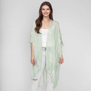 Lightweight, solid kimono with lace detailing and short sleeves. 35% viscose and 65% polyester. One size fits most.