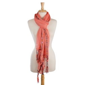 """Lightweight, solid scarf with an aztec print along the edge and tassel accents. 100% viscose. Measures 28"""" x 80"""" is size."""