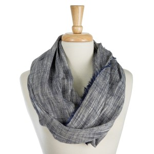 """Lightweight, solid infinity scarf with a stitched line pattern and frayed edges. 100% cotton. Measures 20"""" x 38"""" in size."""