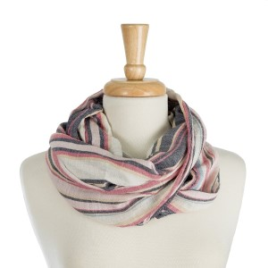 """Lightweight, infinity scarf with a stripe print. 100% polyester. Measures 20"""" x 30"""" in size."""