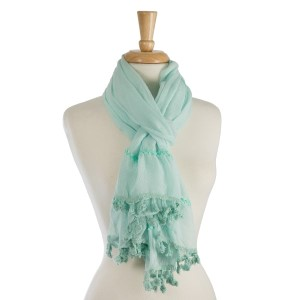 "Lightweight, solid scarf with stitching and tassel details along the bottom. 65% polyester and 35% viscose. Measures 36"" x 72"" in size."