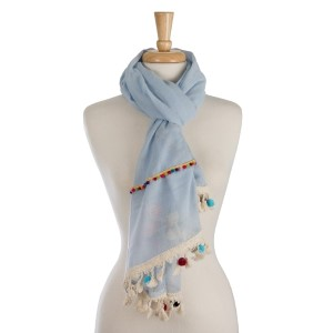 """Lightweight, solid scarf with colorful pom pom trim along the edge. 100% polyester. Measures 27"""" x 72"""" in size."""