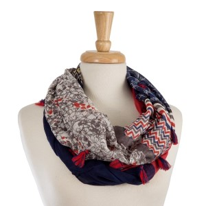 "Lightweight, floral and aztec printed infinity scarf with tassel accents. 100% cotton. Measures 21"" x 34"" in size."