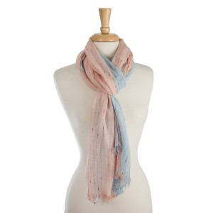 "Lightweight, solid print, colorblock scarf. 100% polyester. Measures 35"" x 76"" in size."