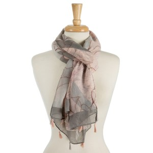 "Lightweight, open scarf with a whimsical print and tassels on the ends. 100% polyester. Measures 27"" x 72"" in size."