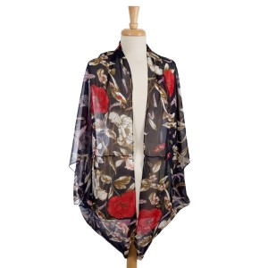 Lightweight, short sleeve cocoon kimono with a floral print. 100% polyester. One size fits most.