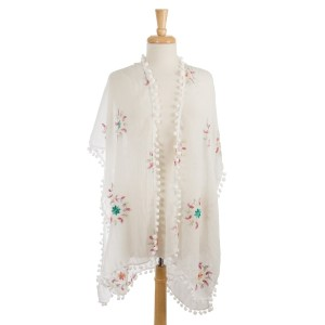 Lightweight, short sleeve kimono with floral embroidery and a pom pom trim. 100% polyester. One size fits most.