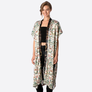 Lightweight, short sleeve ivory kimono with a floral print and black trim. 100% polyester. One size fits most.