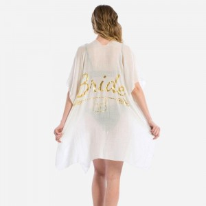 Lightweight, short sleeve kimono with a wedding theme, metallic gold print on the back. 100% viscose. One size fits most.