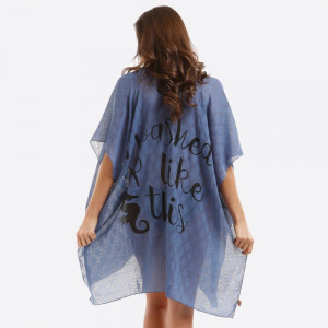 "Lightweight, kimono/swimsuit cover up with ""I washed up like this"" on the back. 100% viscose. One size fits most."