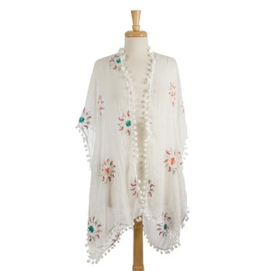 """Embroidered kimono with pom pom trim. 55"""" at longest point. Can also be a great bathing suit cover up. 100% viscose. One size fits most."""