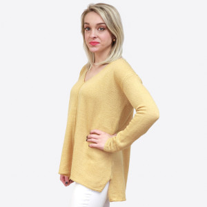 Lightweight V-neck sweater with a relaxed fit and a slight high-low hemline. 100% acrylic. Sold in packs of six - two small, two medium, two large.