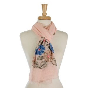 """Lightweight, open scarf with floral embroidery on the ends. 50% cotton and 50% viscose. Measures 27"""" x 70"""" in size."""