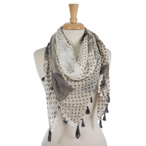 """Lightweight square scarf with a tribal print and tassel accents. 100% viscose. Measures 42"""" x 42"""" in size."""