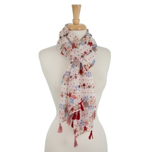 """Ivory, lightweight scarf with a floral print and tassel accents. 100% polyester. Measures 28"""" x 72"""" in size."""